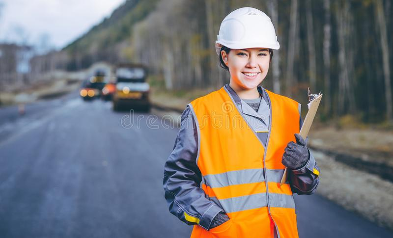 Female worker road construction. Infrastructure repair pavement stock images