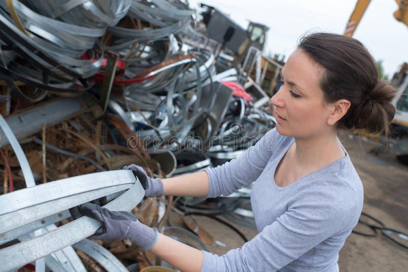 Female worker at scrap metals stock photos