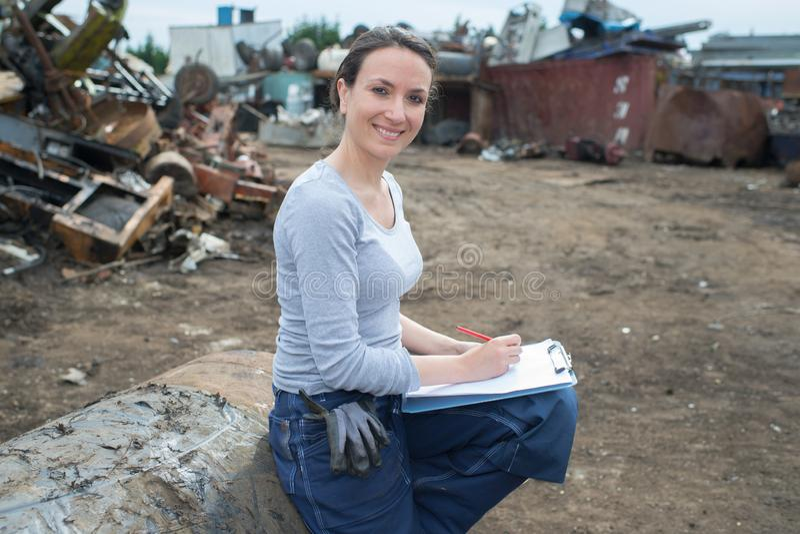 Female worker in scrapyard stock photo