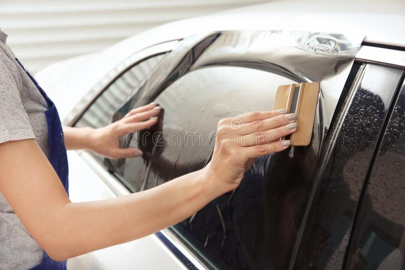 Female worker tinting stock photos