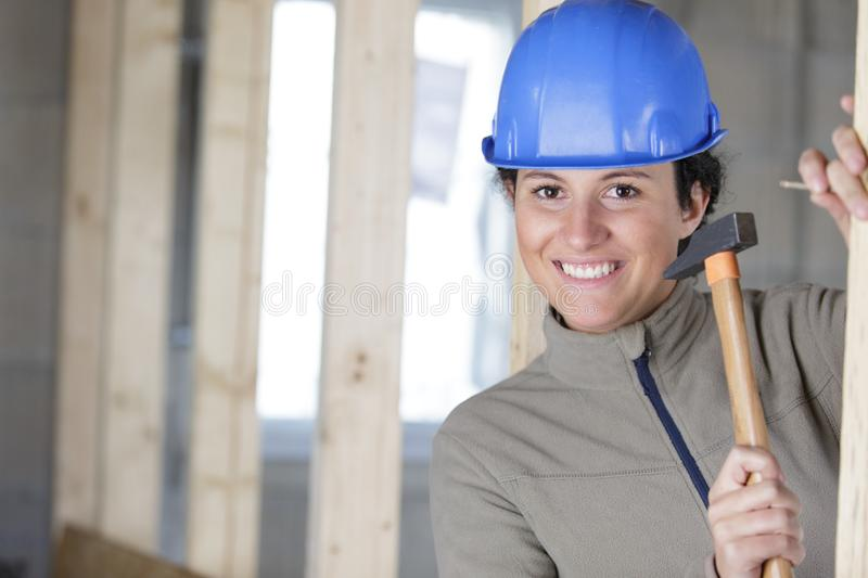 Female worker using hammer royalty free stock photography
