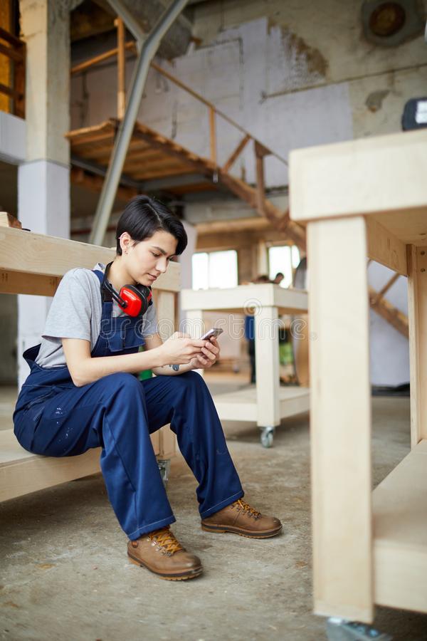 Female Worker Using Smartphone at Break stock photography