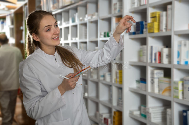 Female working in chemist shop. Female technician working in chemist shop stock photography