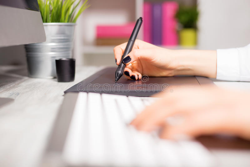 Female working on her drawing pad royalty free stock image