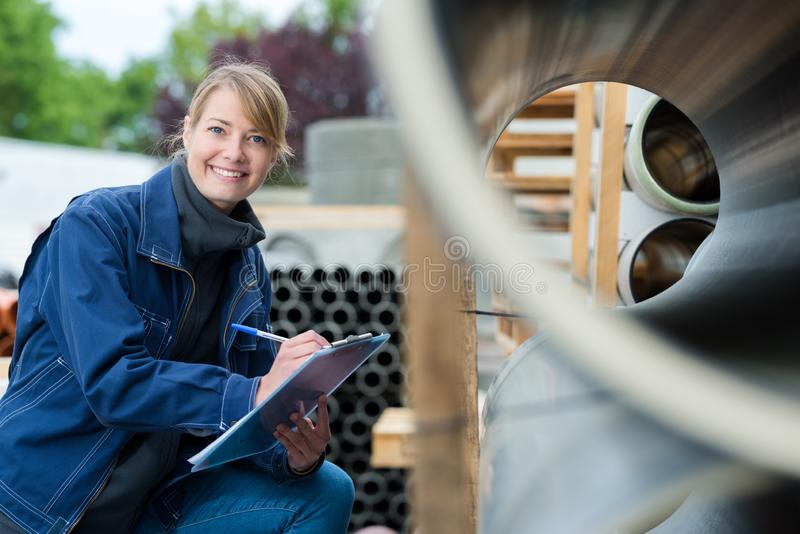 Female working with pipes stock photography