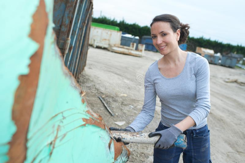 Female working at scrap yard stock photography