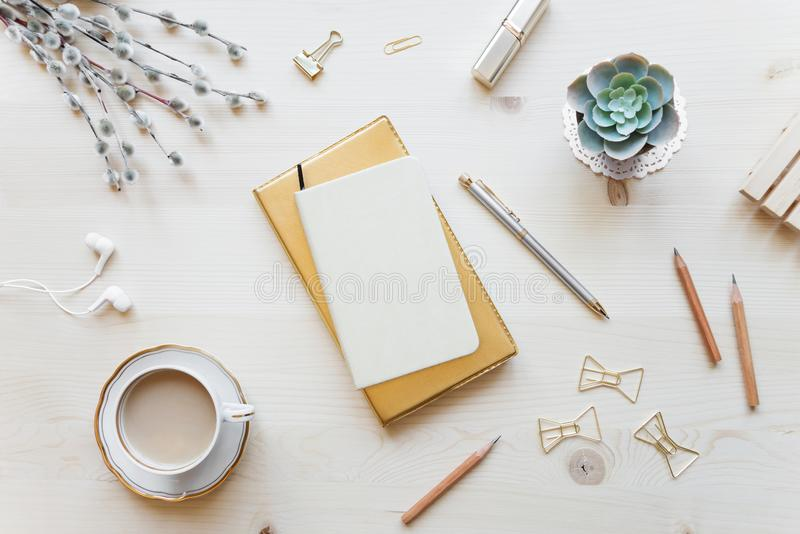 Female working space in golden tones royalty free stock image