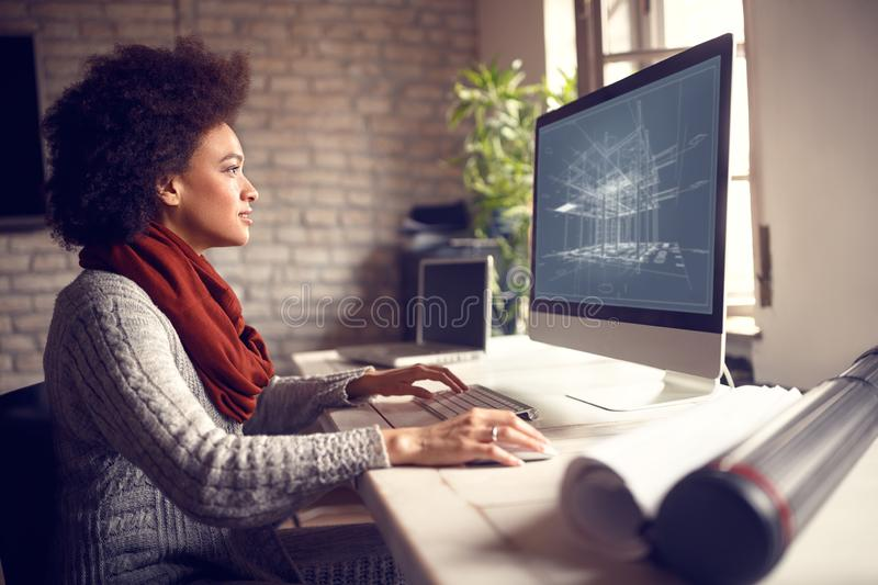 Female works on architect project at her workplace stock image