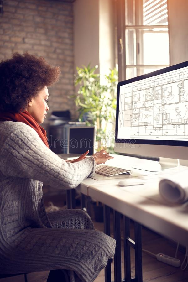 Female works in architect project office royalty free stock photography