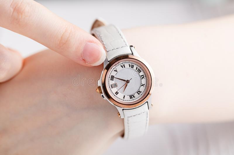 Female wrist warch on arm royalty free stock image