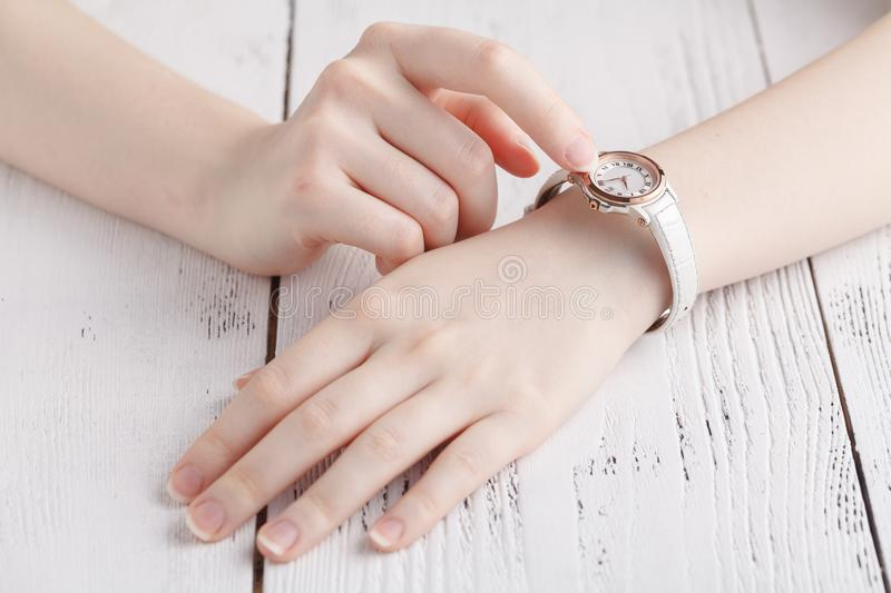 Female wrist warch on arm stock image