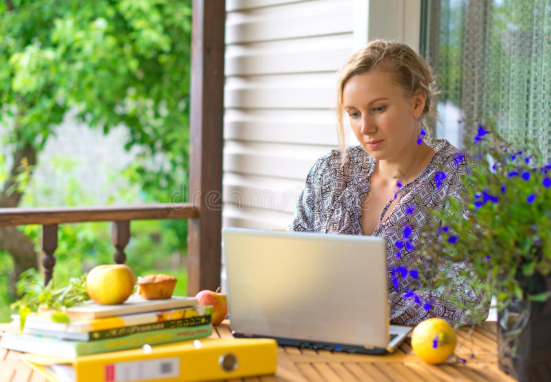 a freelance copywriter typing a checklist on her laptop