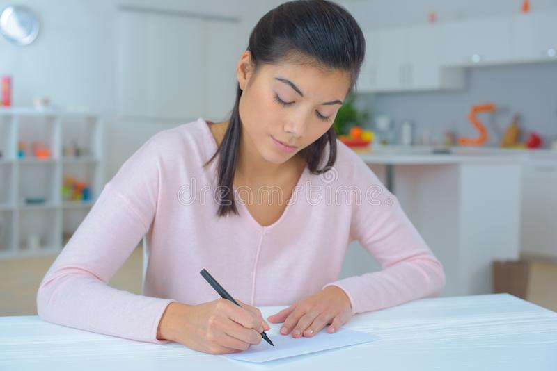Female writing a letter. Female stock image