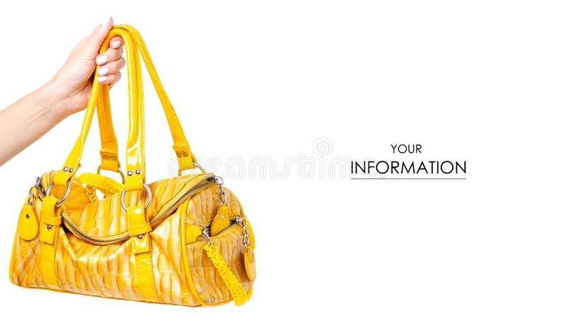 Female yellow leather bag in hand pattern stock photo