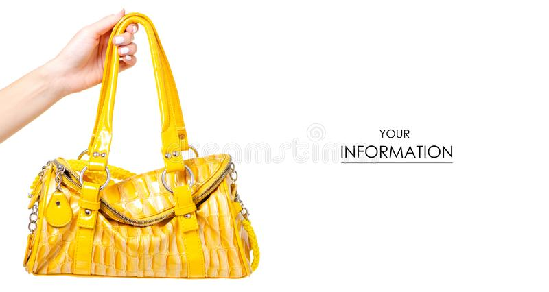 Female yellow leather bag in hand pattern royalty free stock images
