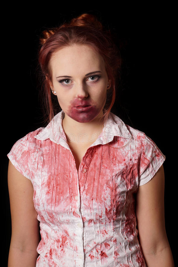 Female zombie. With blood splatter royalty free stock image