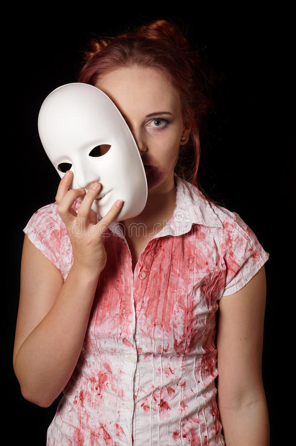 Female zombie with halloween mask. And bloody shirt royalty free stock photography