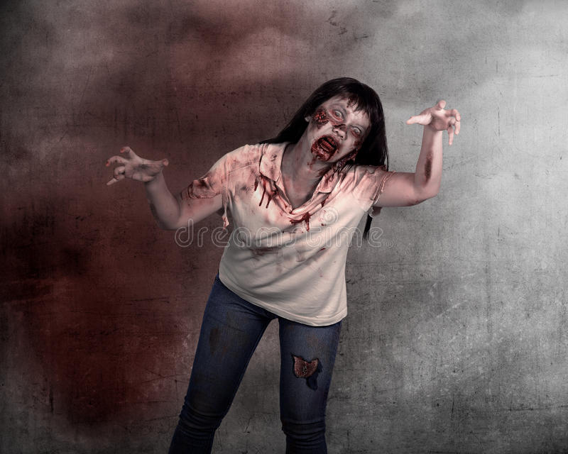Female zombie over grunge background. Halloween concept royalty free stock photos