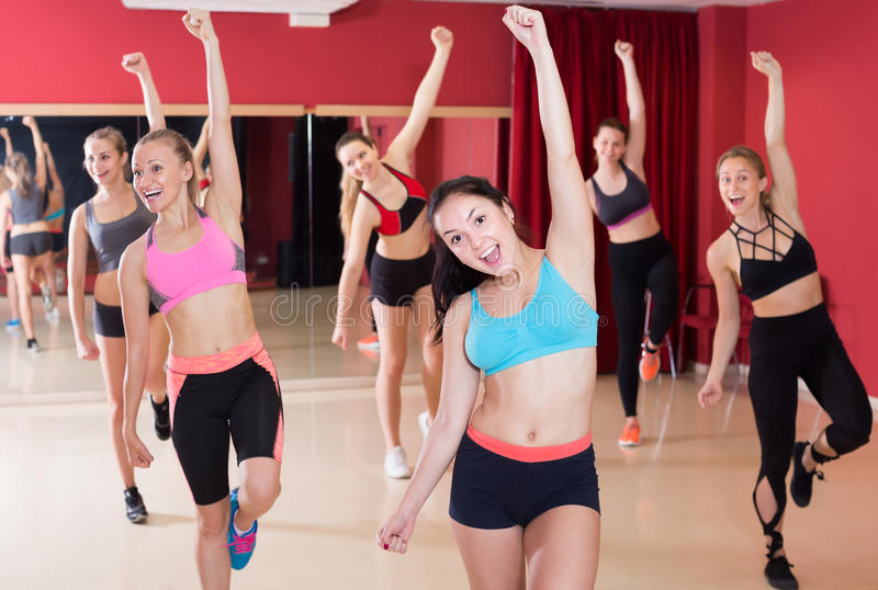 Females exercising dance moves royalty free stock photography