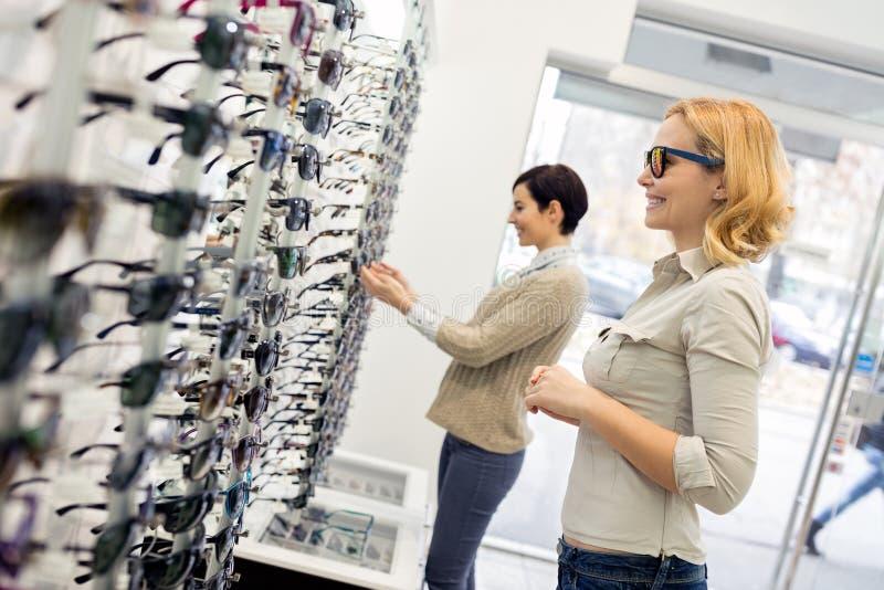 Shopping of eyeglasses stock photos
