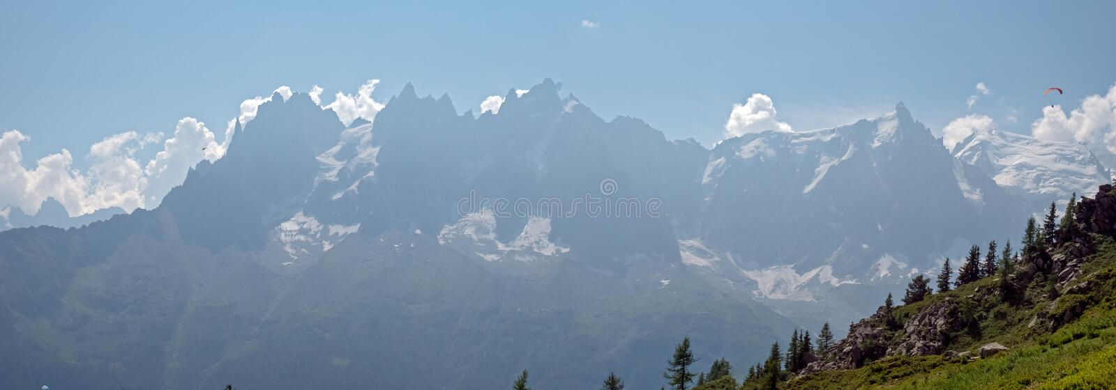 Females hikers enjoy the views ver the valley of Chamonix, France and toward Mont Blanc in the Alps. stock image