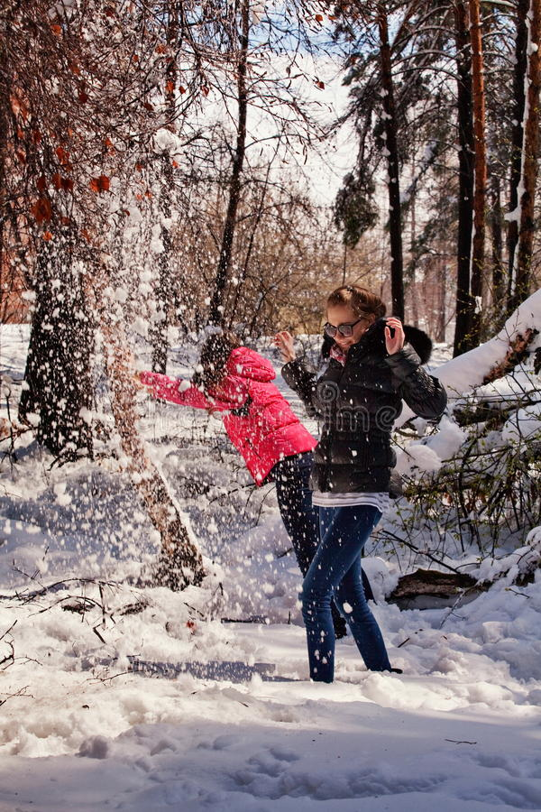 Females Playing In Snow Royalty Free Stock Photography