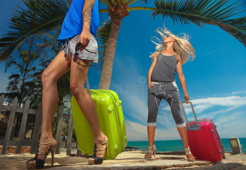 Females with a suitcases stock photography