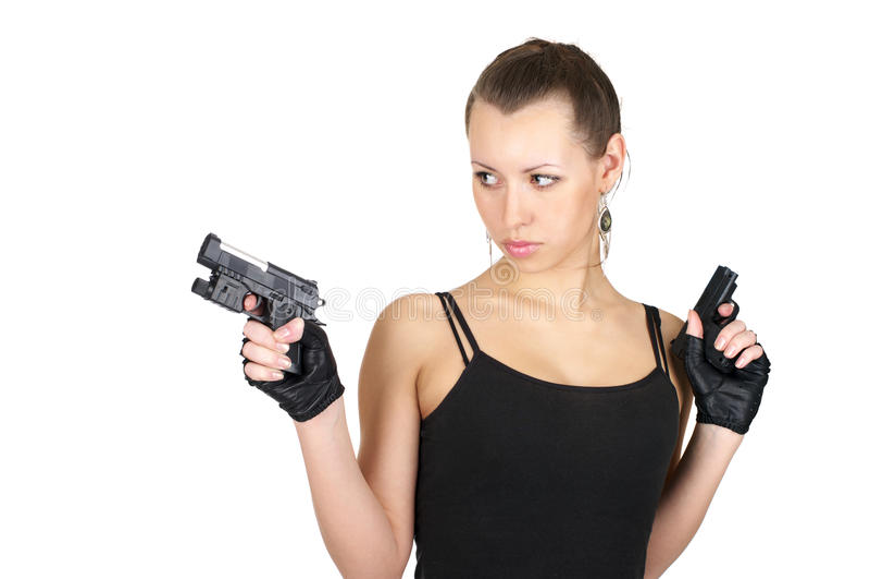 Femelle attirante avec deux pistolets photos libres de droits