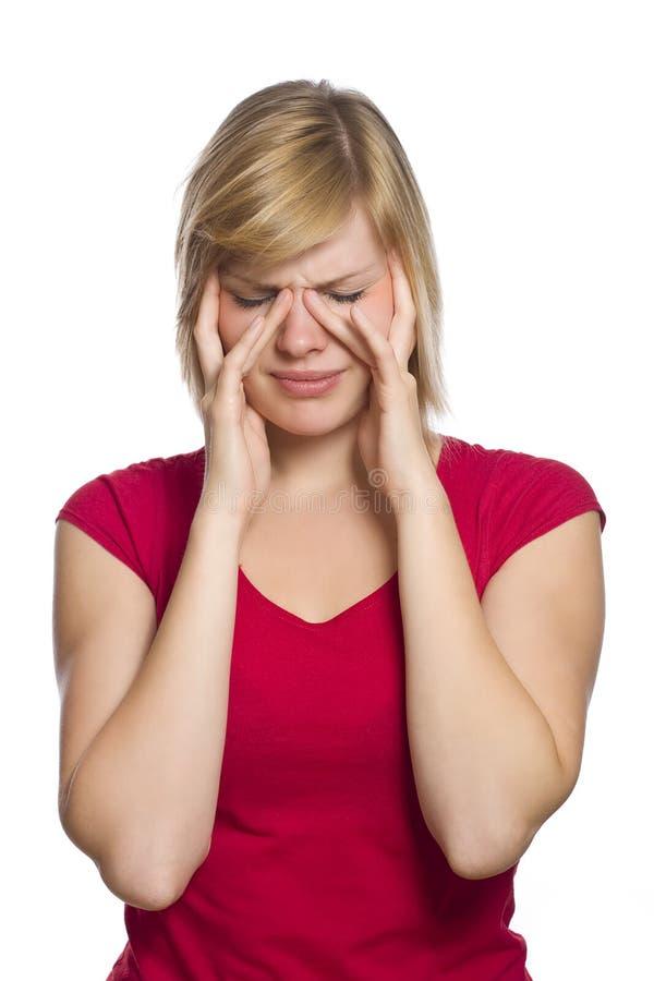 femelle blond ayant le mal de tête image libre de droits