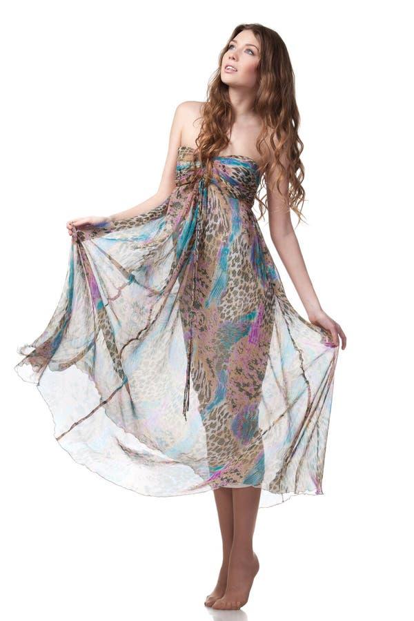 Femelle dans la robe de mousseline de soie images stock