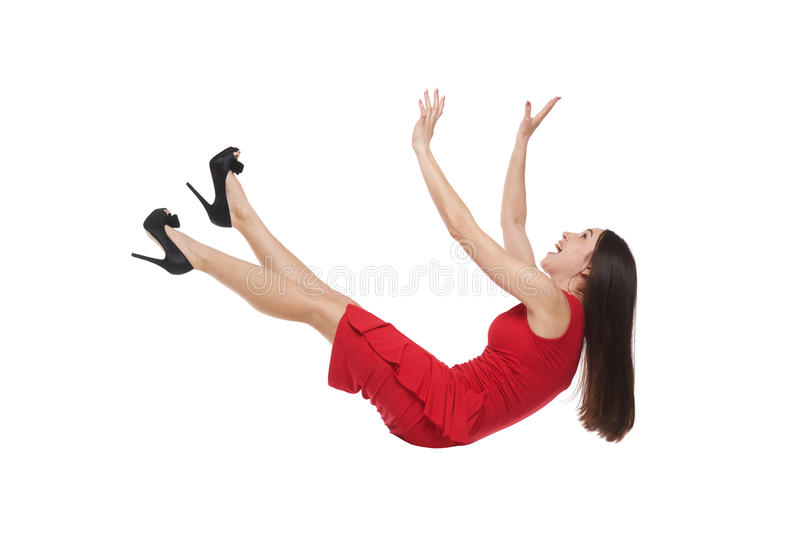 Femelle dans la robe rouge tombant vers le bas photo libre de droits