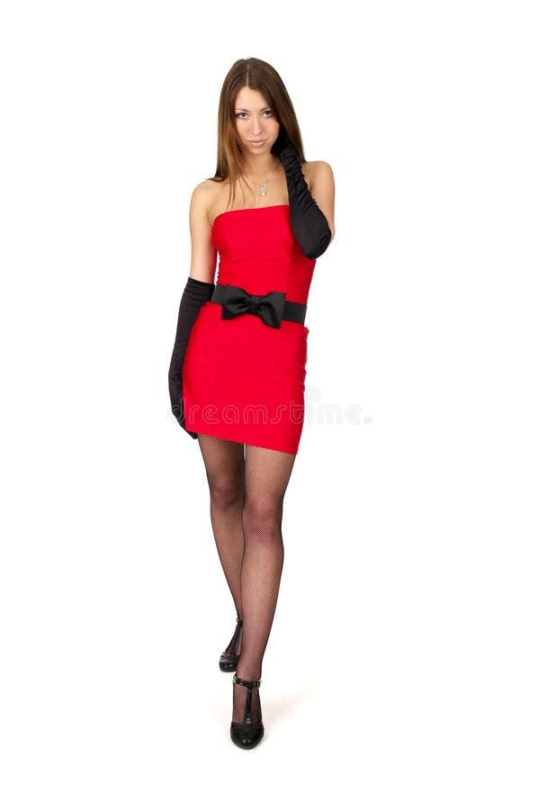 Femelle sexy dans peu de robe rouge photographie stock libre de droits