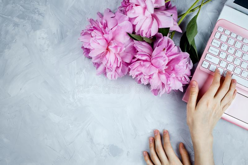 Feminine business mockup with peonies bouquet and woman`s printing royalty free stock photo