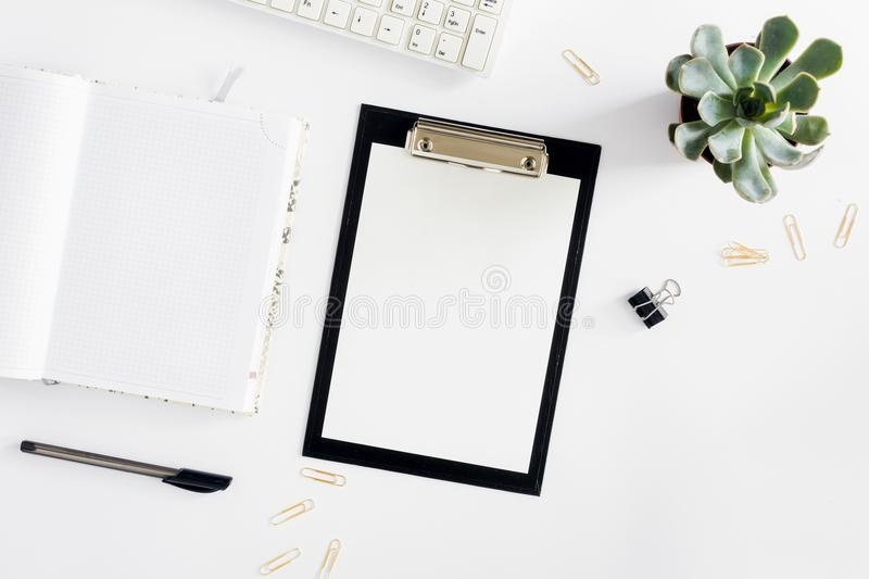 Feminine desk workspace succulent, clipboard, diary, keyboard, g royalty free stock image