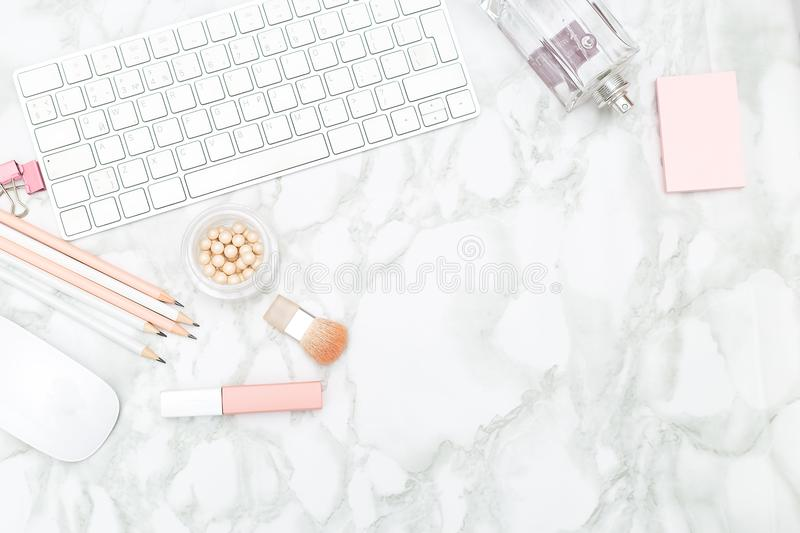 Feminine desktop with stationery and perfume. Copy space royalty free stock photos