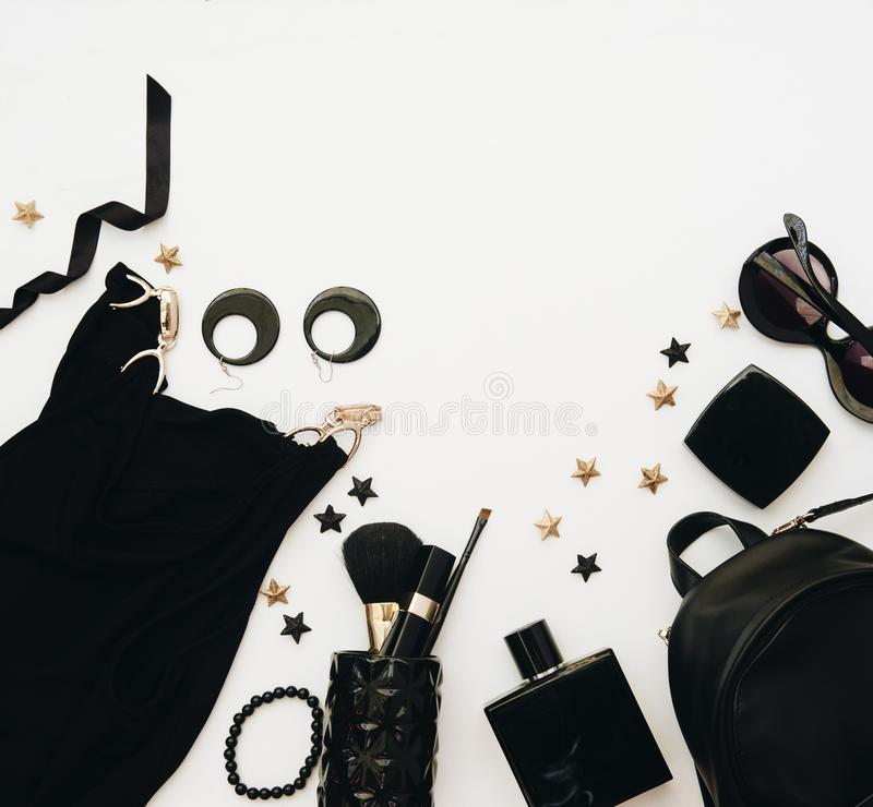 Feminine flat lay with glasses, lipstick, perfume, watch, pendant on white. royalty free stock photography