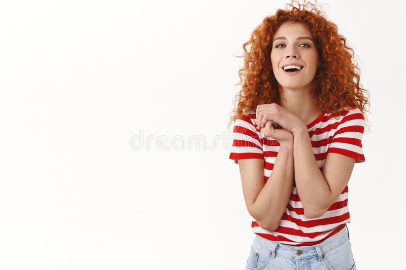 Feminine good-looking curly redhead ginger girl look playful positive press palms thankful together appreciate nice royalty free stock images