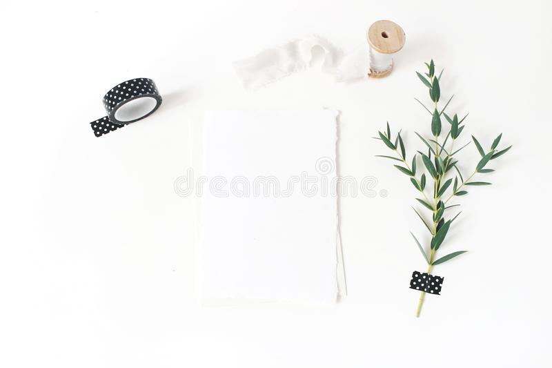 Feminine stationery, wedding desktop mock-up scene. Blank greeting card, envelope,black washi tape, silk ribbon and royalty free stock images