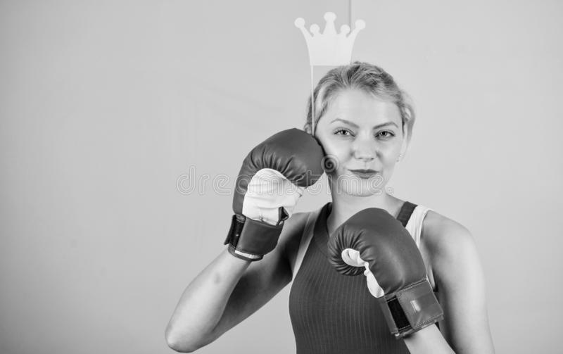 Feminine tender blonde with queen crown wear boxing gloves. Fight for success. VIP gym. Fighting queen. Woman boxing royalty free stock image