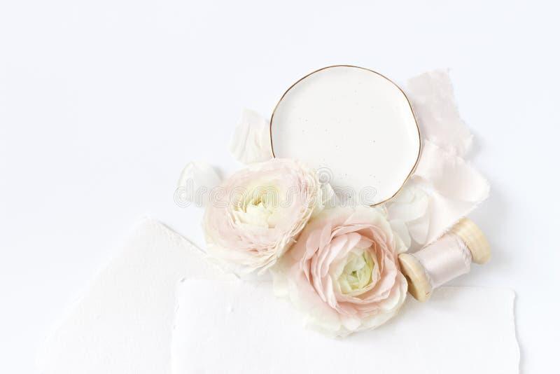 Feminine wedding, birthday desktop mock-up scene. Porcelain plate, blank craft paper greeting cards, silk ribbon, blush stock images
