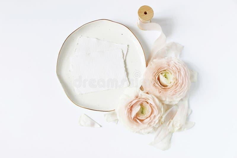 Feminine wedding, birthday desktop mock-up scene. Porcelain plate, blank craft paper greeting cards, silk ribbon, blush stock photo