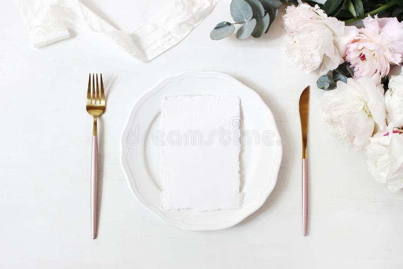 Feminine wedding, birthday desktop mock-up scene. Porcelain plate, blank craft paper greeting cards, silk ribbon, golden royalty free stock photos