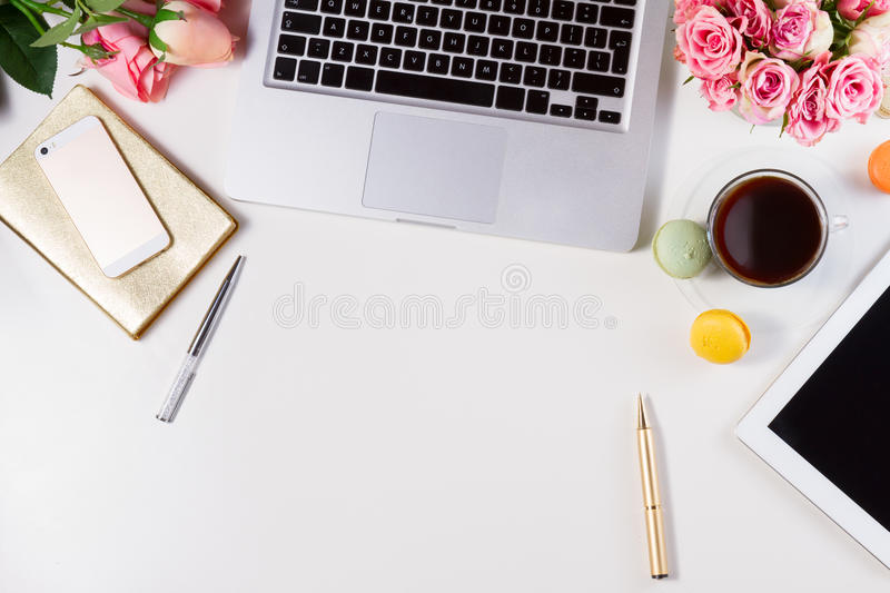 Feminine workspace, top view royalty free stock image