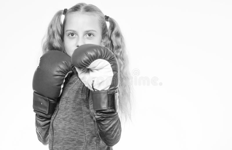 Feminist movement. Self defence concept. Girl boxer knows how defend herself. Girl child strong with boxing gloves. Posing on white background. She ready to royalty free stock photos