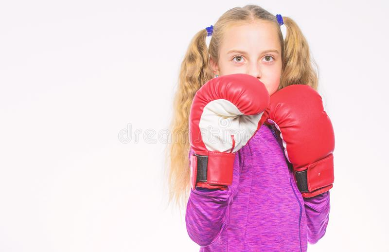 Feminist movement. Self defence concept. Girl boxer knows how defend herself. Girl child strong with boxing gloves. Posing on white background. She ready to stock photo