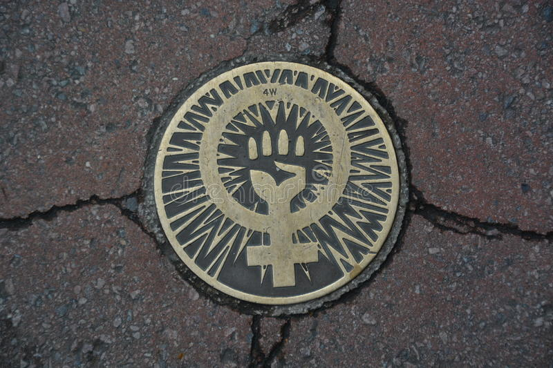 Feminist sign. A feminist sign on the street pavement stock image