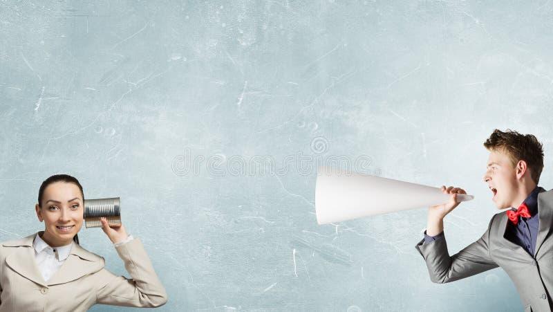 Femme à l'aide du téléphone sourd image libre de droits