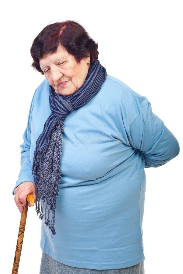 Femme âgée avec douleur dorsale photographie stock libre de droits