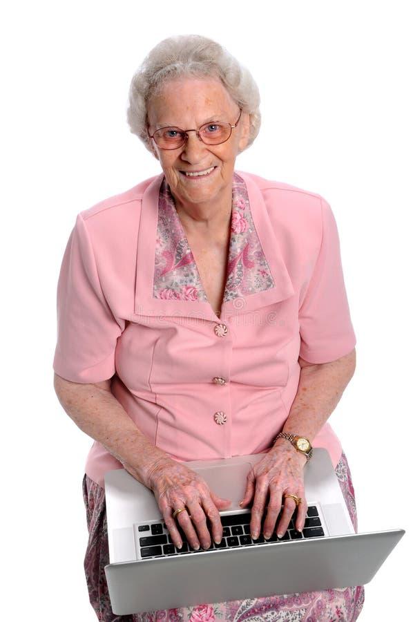 Femme âgée avec l'ordinateur portatif photos libres de droits