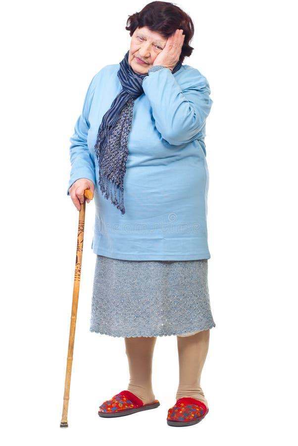 Femme âgée avec la durée dure photographie stock libre de droits